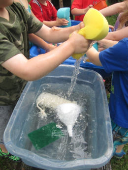 Children playing with sponges